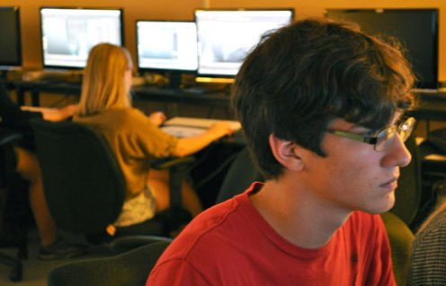 Troy Jacobsen of Boswell High School in Fort Worth works on a 3-D model of his video game character during a June 17 session of SEED 2013. (Photo by James Dunning)