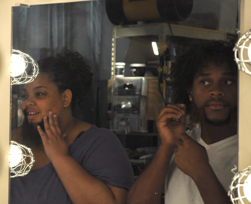Communication senior Kashari Mitchell, left, and Theatre Arts senior Winston Daniels apply facial prosthetics and hair to make realistic mustaches and beards during their Theatrical Makeup class this summer. (Photo by James Dunning)