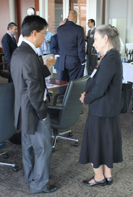 "Associate Professor Wei Chen (Phyics), left, and Dean of Liberal Arts Beth Wright chat during a recent reception for the SAVANT Center, a UT Arlington group studying ""security advances via applied nanotechnology."" (Photo contributed)"