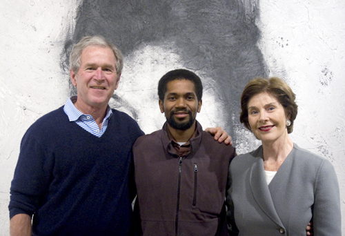"Former President George W. Bush, left, and former First Lady Laura Bush, right, visited with Assistant Professor Sedrick Huckaby (Art & Art History) for a private viewing of Huckaby's exhibit, ""Everyday Glory,"" at the Valley House Gallery in Dallas last month. The collection of paintings was on display through Jan. 11. (Photo by Valley House Gallery & Sculpture Garden)"