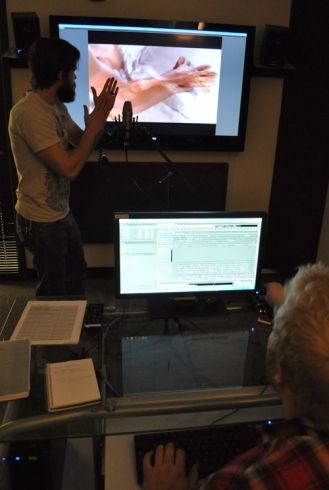 Film graduate students Ryan Britton, left, and Brendan Felturp-Exum, right, demonstrate the automatic dialogue replacement process in the Department of Art & Art History's sound studio.