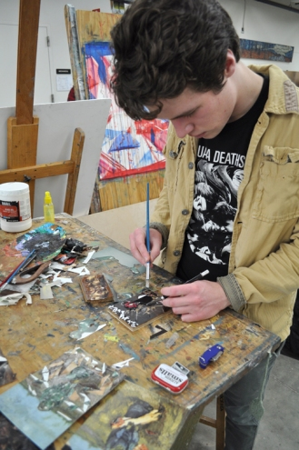 Art senior David Cooper works on a project during the Department of Art & Art History's open house Jan. 31.