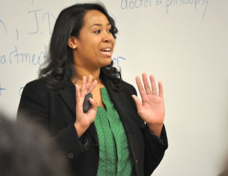Brittany Dunn, Assistant District Attorney for Dallas County, speaks with Arlington ISD students April 2 at a workshop on the UT Arlington campus. Students spent part of the day learning from Pre-Law Center students and faculty. (Photo by James Dunning)