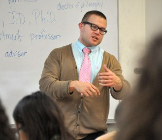 Oliver Bateman, Assistant Professor of History and Faculty Advisor for the UTA Moot Court team, talks to Arlington ISD students during an April 2 workshop on the UT Arlington campus. (Photo by James Dunning)
