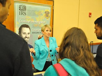 Special Agent Denise Corcoran talks with students about opportunities to work with the U.S. Department of Treasury during the Department of Criminology & Criminal Justice Career Fair on April 16. The event was sponsored by the Alpha Phi Sigma Honor Society. (Photo by James Dunning)
