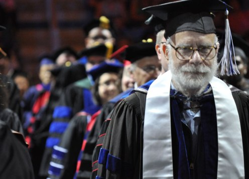 Faculty during the processional of the May 2014 College of Liberal Arts Commencement ceremony May 9, 2014, at the College Park Center. (Photo by James Dunning)