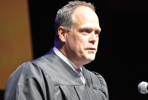 Alumnus Gerry Mecca gives the keynote address at the May 2014 College of Liberal Arts Commencement ceremony May 9, 2014, at the College Park Center. (Photo by James Dunning)