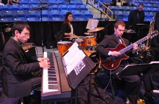 Members of the UT Arlington music department play during the May 2014 College of Liberal Arts Commencement ceremony May 9, 2014, at the College Park Center. (Photo by James Dunning)