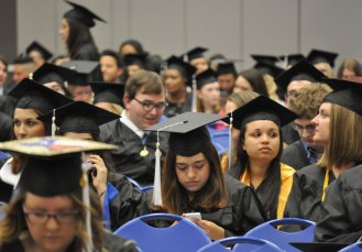 Students wait for the beginning of the May 2014 College of Liberal Arts Commencement ceremony May 9, 2014, at the College Park Center. (Photo by James Dunning)