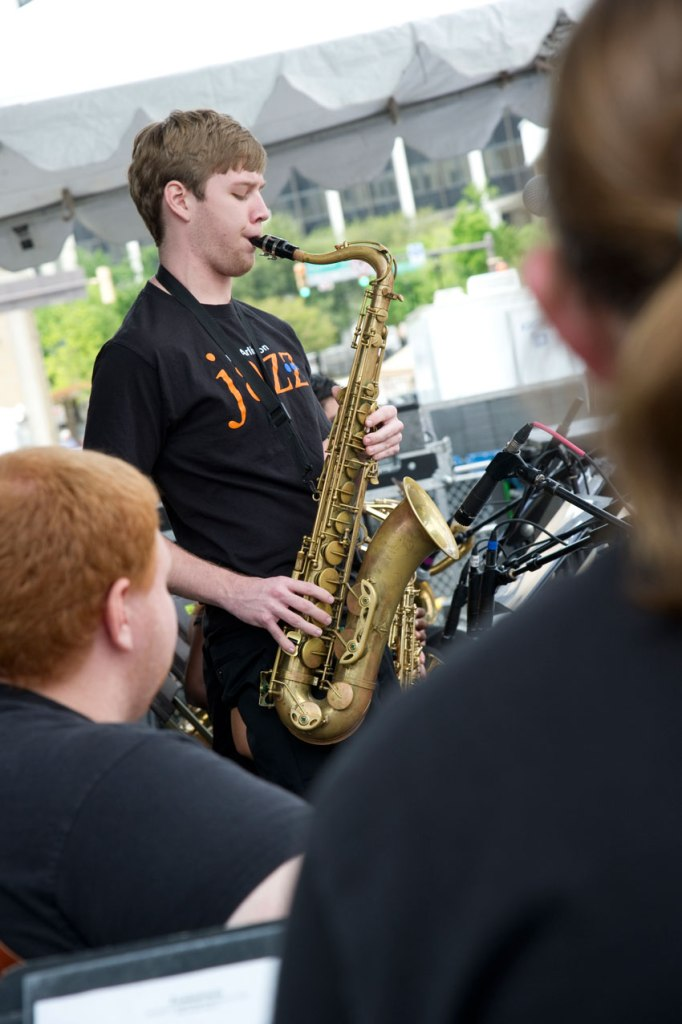 Freshman Dylan Brown, a jazz studies major, plays saxophone during the UT Arlington jazz band's show at the Main Street Fort Worth Arts Festival last month. The University was a major sponsor and had a strong presences at the event. View more pictures from UTArlington Magazine online.