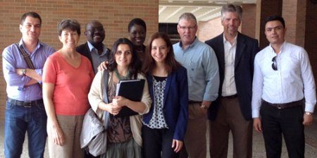 Associate Professor Andrew Clark (third from right) and Assistant Professor Mark Tremayne (second from right) hosted an international group of journalists sponsored by the U.S. State Department on June 20. The professors discussed their research on drone journalism and presented information about Department of Communication. Event participants traveled from a number of different countries including Romania, Ghana and Romania. (Photo contributed)