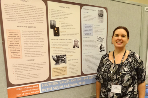 Assistant Professor Pribanic-Smith poses in front of the poster she created for the Association for Education in Journalism and Mass Communication National Conference in Montreal in August. The entry won Best Poster in the History Division. (Photo contributed)