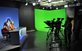 "The newly renovated broadcast studio updates the news set and includes a new ""green screen"" corner for advanced production work. (James Dunning/COLA Communications)"