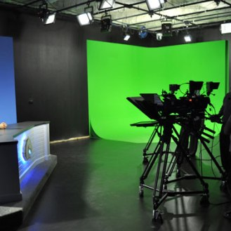 """The newly renovated broadcast studio updates the news set and includes a new """"green screen"""" corner for advanced production work. (James Dunning/COLA Communications)"""