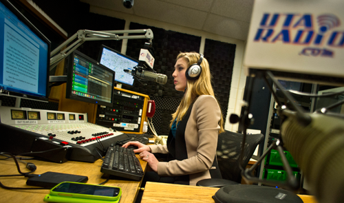 Broadcast graduate Tracie Hill ('14) works in the UTA Radio studios last semester. The station's newscast recently claimed first prize in the South Central Broadcasting Society's regional conference. (Photo contributed)