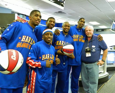 Lecturer Austin Robinson, right, poses with members of the Harlem Globetrotters at a media event earlier this month. (Photo contributed)