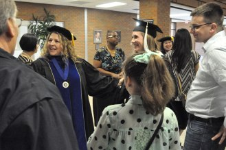Faculty, graduates and families mingle at a reception following the College of Liberal Arts MA hooding ceremony Friday, Dec. 12. (Photo by James Dunning/COLA Communications)