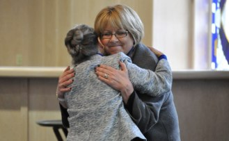 Kim van Noort (right), former Associate Dean of Liberal Arts and current Associate Vice Provost for Undergraduate Studies and Director of University College, hugs Dr. Beth Wright, former Dean of Liberal Arts, greets colleagues and well-wishers at a special reception Jan. 30, 2015, in the E.H. Hereford University Center. (Photo by James Dunning/COLA Communications)