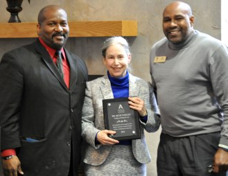 Members of the UTA African American Alumni Association honored Dr. Beth Wright (center), former Dean of Liberal Arts, during a special reception Jan. 30, 2015, in the E.H. Hereford University Center. (Photo by James Dunning/COLA Communications)