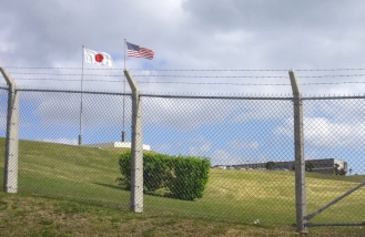 Japanese and U.S. flags fly at a military installation in Okinawa, Japan. (Photo contributed)