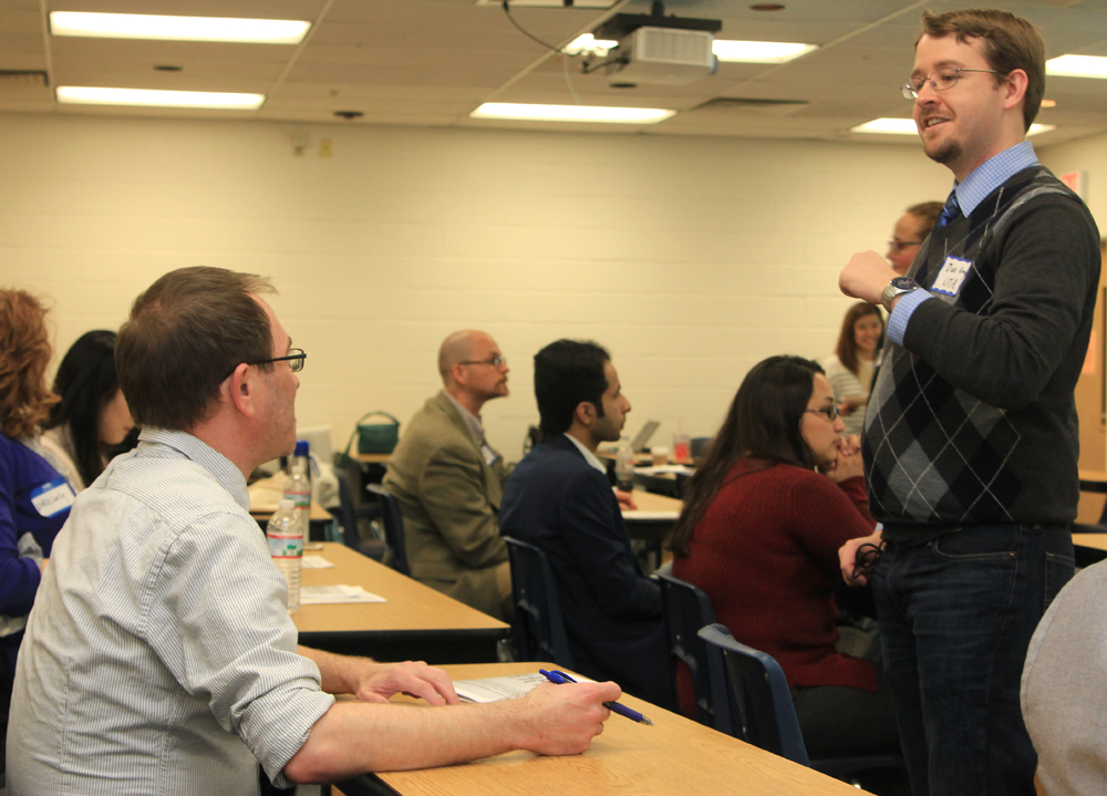Doctoral candidate Dan Amy (Linguistcs & TESOL), right, talks with a group during the 22nd annual UTA Student Conference in Linguistics and TESOL conference held Feb. 19-20. Scholars from across the globe attended the event. (Photo by Les Riding-In/COLA)
