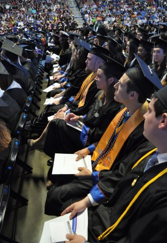 Graduating students listen Friday, May 15, during the College of Liberal Arts' Spring 2015 Commencement at College Park Center. (Photo by James Dunning/COLA Communications)