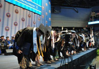 Theatre Arts students take a bow Friday, May 15, at the College of Liberal Arts' Spring 2015 Commencement at College Park Center. (Photo by James Dunning/COLA Communications)