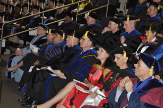 Faculty participate in the College of Liberal Arts master's hooding ceremony May 15 in the Mavericks Activity Center. (Photo by James Dunning/COLA Communications)
