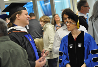 Faculty, students, family and friends celebrate graduation at a reception following the master's hooding ceremony May 15 in the Mavericks Activity Center. (Photo by James Dunning/COLA Communications)