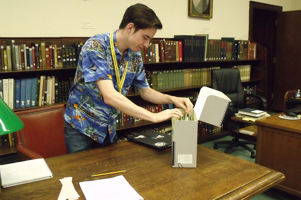 History senior Trevor Engel looks through archived records at the Mütter Museum in Philadelphia this summer. (Photo contributed)