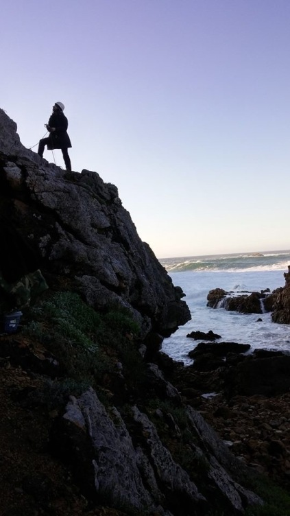 Assistant Professor Naomi Cleghorn (Anthropology) stands outside the dig site near Knysna, South Africa. (Photo contributed)