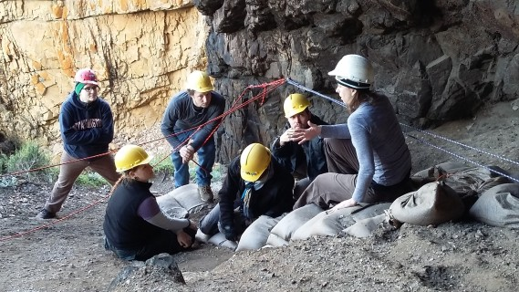 Assistant Professor Naomi Cleghorn (Anthropology), right, instructs her team this summer at a dig site near Knysna, South Africa. (Photo contributed)